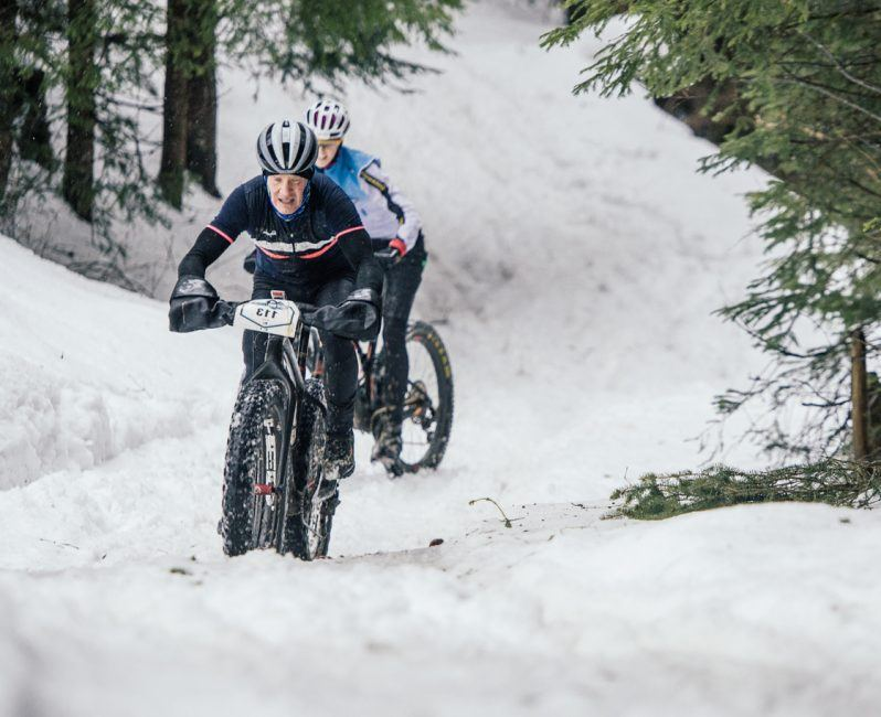 Snow Bike Festival Stage 3 in the trees by Wayne Reiche