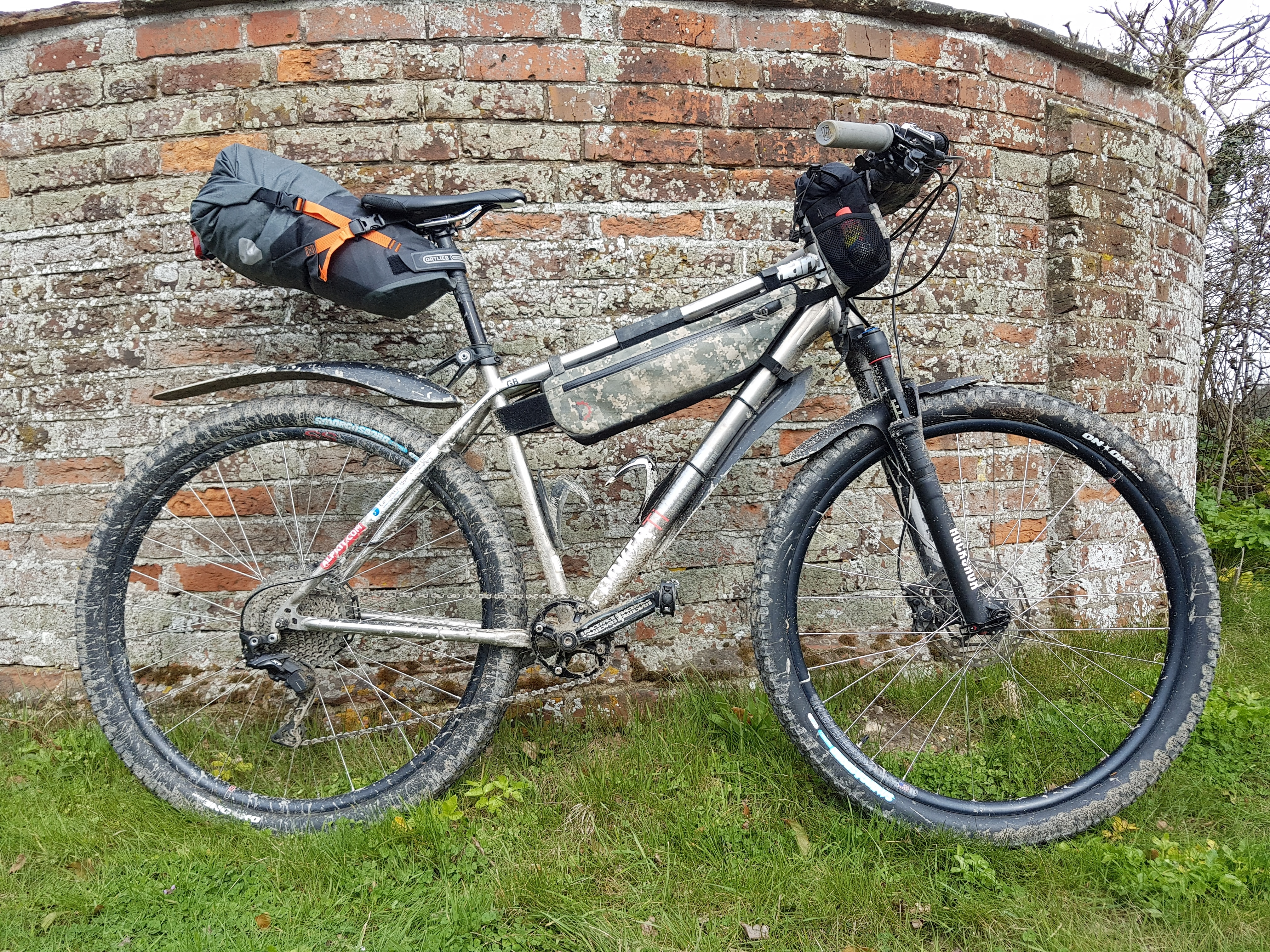 8d7f28187bab00 I'm not going to get into the debate about what separates touring and  bikepacking, but using soft luggage instead of racks & panniers would be a  popu ...