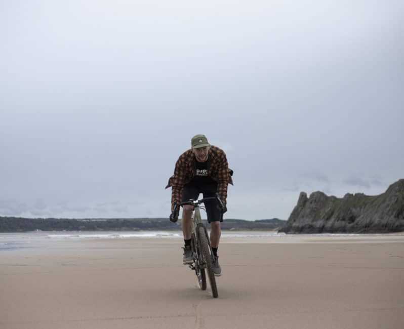 The Overland solo rider on beach