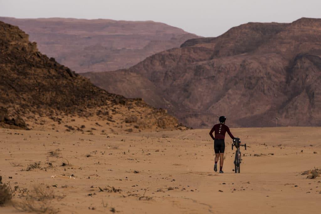 Hiking with bike through the Wadi Desert