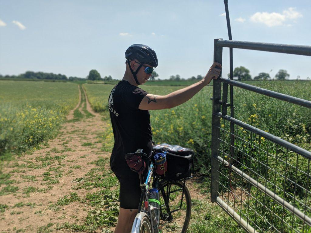 John opening a bridleway gate