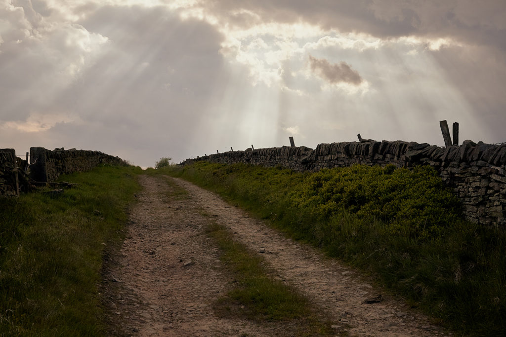Gravel tracks lined by dry stone walls in the peak district